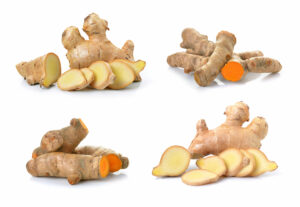 Raw Ginger and Turmeric on a white background
