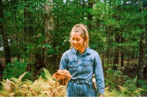 Danielle Ryan Broida from Four Sigmatic Holding a mushroom