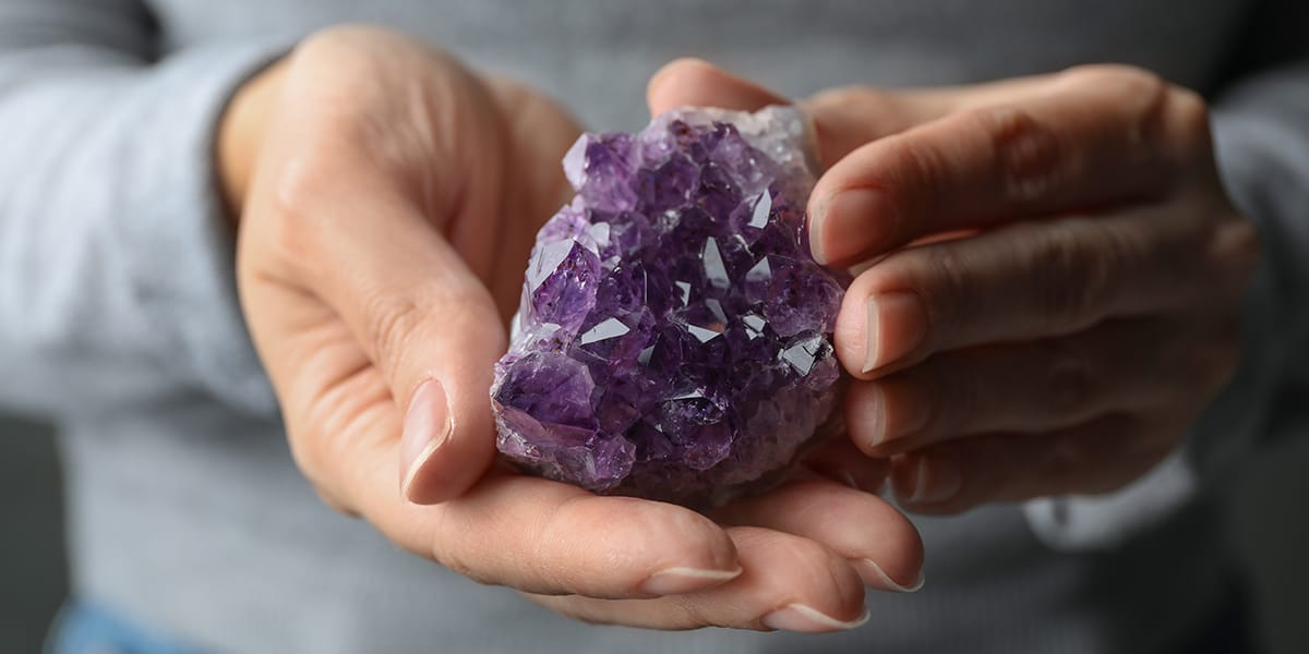 Women Holding Healing Crystals