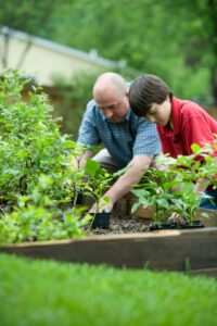 A family gardens in their backyard to aid their community.