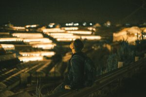 A wanderer in a cityscape.