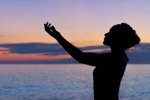 A woman practicing Reiki for wellness.